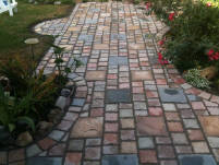 Cobblestone Concrete Pavers made and installed by homeowner Kevin Brandon.
