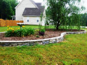 Ledgestone garden wall made by homeowner Scott Sellers.